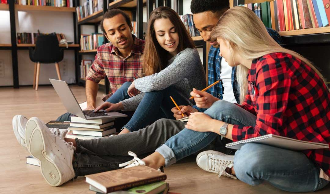 young-concentrated-students-sitting-in-library-on-PUQTC74
